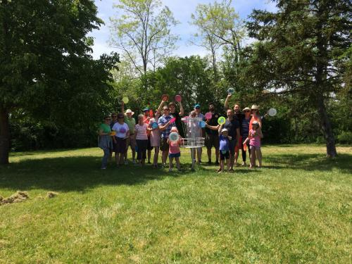 Participants of all ages enjoying a round of disc golf at Haliburton House